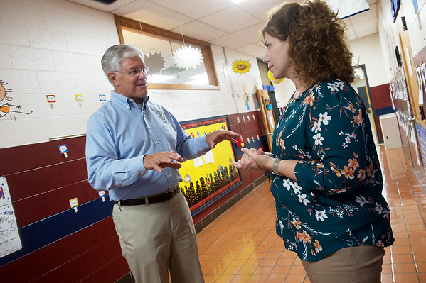 David Maurstad, director of the mitigation division for FEMA, talks with Dana Stokesbary, fourth grade teacher at Kelsey Norman Elementary, about the school's saferoom during a visit on Tuesday.<br /> Globe | Roger Nomer