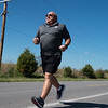 Bobby Ballard runs near his home in Joplin on Monday.<br /> Globe | Roger Nomer