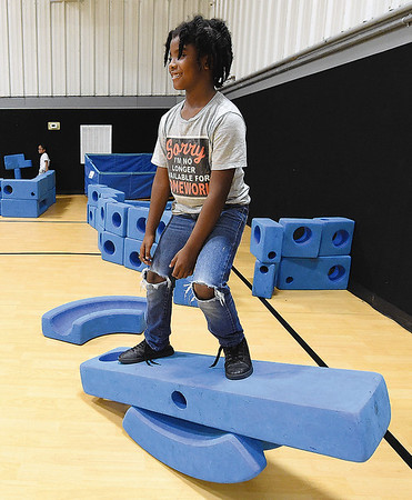 Six-year-old Markus Dennis makes a one-man teeter totter out of blue blocks on Tuesday afternoon at the Boys and Girls Club of Southwest Missouri.<br /> Globe | Laurie Sisk