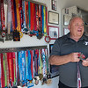 Bobby Ballard talks about his finishers medal for the first marathon he completed during an interview on Monday.<br /> Globe | Roger Nomer