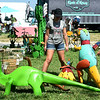 Gwen Pugh, 11 and Payton Campmier, 11, check out large metal sculptures of dinosaurs during the Pickin' on the Ranch Fall Pickers Market on Saturday at Westwoods' Civil War Ranch near Carthage. The semi-annual event continues today from 10 a.m. to 4 p.m. with dozens of vendors.<br /> Globe | Laurie Sisk