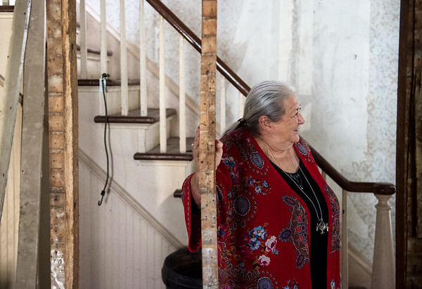 Judy Goff, board member with Carthage Historic Preservation, talks about restoration efforts at the Sweet House on Tuesday in Carthage.<br /> Globe | Roger Nomer