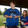 Nine-year-old Madison Cox assists Mary Jo Martin as they award door prizes to participants in Saturday's Joplin Team Hope Walk at Landreth Park. The walk raises money to help support those afflicted with the disease and to spread awareness about Huntington's disease. The event was organized by the Huntington Disease Society of America's Missouri Chapter.<br /> Globe | Laurie Sisk