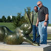 "Jason Cowen, Joplin Parks superintendent, left, and Paul Bloomberg, Parks and Rec director, check out the ""Rabbit Reach"" sculpture in Mercy Park on Tuesday.<br /> Globe 