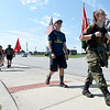 "Allison Robbins, 15, right, and Josiah Starr, 12 of Carl Junction Scout Troop 70, make their way up McClellansd Blvd. during the ""Let's Roll '19 Ruck March"" on Saturday. The event, sponsored by Compass Quest, included about 30 participants who hiked the 14-mile course to raise awareness concerning veteran's issues.<br /> Globe 