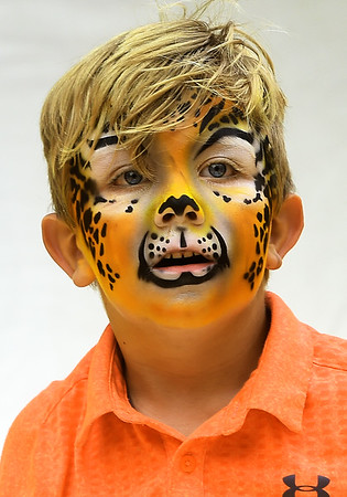 Six-year-old Abram Randall sports a ferocious look after taking advantage of face painting during the Carl Junction Bluegrass Festival on Saturday at Center Creek Park. <br /> Globe | Laurie Sisk