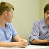 Seventeen-year-old Dillon Dodge, right, discusses low voter turnout as Jake Saunders, 16, listens during the inaugural Youth Council meeting on Wednesday night at Joplin City Hall. The council is made up of 11 teens from public and private schools in Joplin.<br /> Globe | Laurie Sisk