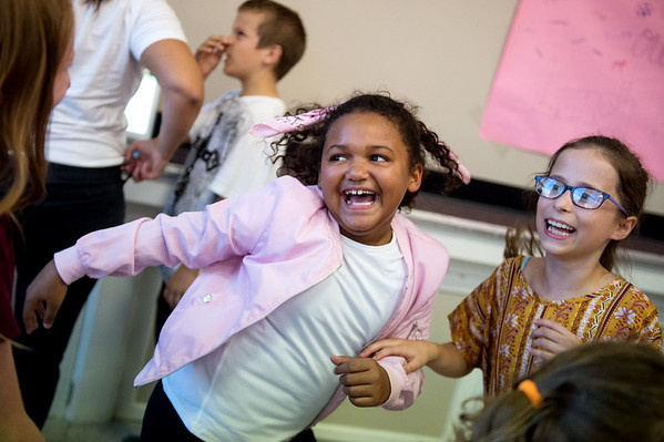 D'Nae Adams, left, and Anie Spiering, fourth graders at Columbia Elementary, dance during Thursday's Sock Hop at the school.<br /> Globe | Roger Nomer