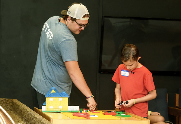 Boys and Girls Club of Southwest Missouri staff member Matt Miller and Logan Noland, 11, get their creative juices flowing with Legos during the club's ummer program on Wednesday at the club. The program concludes Friday at the club.<br /> Globe   Laurie Sisk