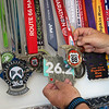 Bobby Ballard talks about his many finishers medals from races he has run during an interview on Monday.<br /> Globe | Roger Nomer