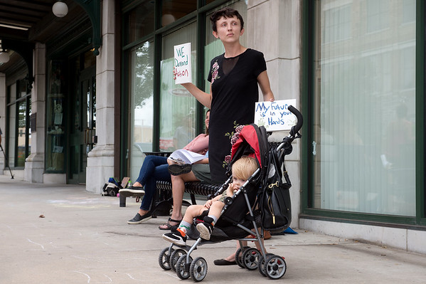 Elizabeth Hilton, Wentworth, attends Friday's local climate strike with her son Patrick Cartnell, 2, at Joplin City Hall.<br /> Globe | Roger Nomer