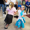Gaddie Stephenson, left, and Brynn Walters, first graders at Columbia Elementary, spin during Thursday's Sock Hop at the school.<br /> Globe | Roger Nomer