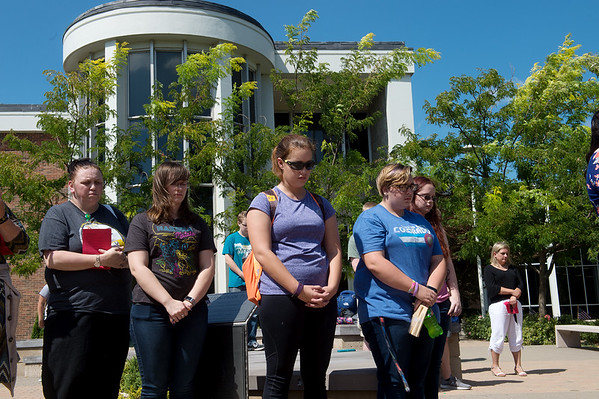 Missouri Southern State University students and staff observe a moment of silence during Wednesday's Sept. 11 rememberance on campus.<br /> Globe | Roger Nomer