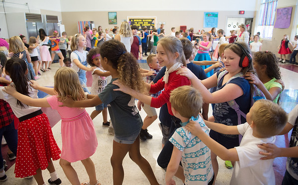 Columbia Elementary students form a chain while dancing at the school's Sock Hop on Thursday.<br /> Globe | Roger Nomer