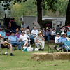 Visitors relax as they enjoy the music of  the Workman Bluegrass Band during the Carl Junction Bluegrass Festival on Saturday at Center Creek Park. The band wasone of several performing at the annual event.<br /> Globe | Laurie Sisk