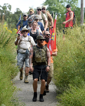 """Compass Quest trainer Matt Hay leads a group of volunteers as they set out on the """"Let's Roll '19 Ruck March"""" on Saturday at Redings Mill Bridge. The event, sponsored by Compass Quest, included about 30 participants who hiked the 14-mile course to raise awareness concerning veteran's issues.<br /> Globe 