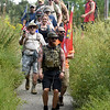 "Compass Quest trainer Matt Hay leads a group of volunteers as they set out on the ""Let's Roll '19 Ruck March"" on Saturday at Redings Mill Bridge. The event, sponsored by Compass Quest, included about 30 participants who hiked the 14-mile course to raise awareness concerning veteran's issues.<br /> Globe 
