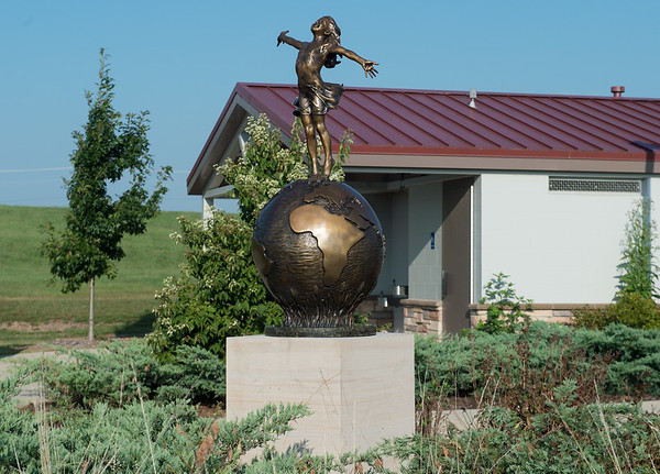 """""""Joyful Empowerment"""" by Angela Mia De La Vega is one of several sculptures in the Rotary Sculpture Garden at Mercy Park.<br /> Globe 