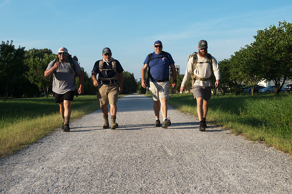 (from left) Enrique Medina, Ted Donaldson, Steven Roberts and Matt Hay participate in a practice ruck on Monday at the Frisco Greenway Trail.<br /> Globe | Roger Nomer