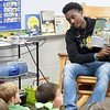 "Missouri Southern basketball player Winston Dessesow reads the book ""How Do Dinosaurs Go to School?"" to kindergartners at Cecil Floyd Elementary on Thursday morning. Dessesow was one of three MSSU players to read to kids at the school.<br /> Globe 