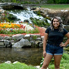 "Arely Avitua stands in front of the water feature at Big Spring Park in Neosho on Wednesday. Avitua recently was the youngest cast member of the MTV-produced reality show, ""The Real World.""<br /> Globe 