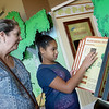 Jill Dinges and her daughter Nevaeh, 11, look at the new exhibits at the Shoal Creek Conservation Education Center open house on Friday.<br /> Globe | Roger Nomer