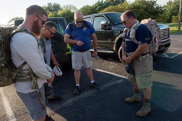 (from left) Matt Hay, Enrique Medina, Steven Roberts and Ted Donaldson pray before Monday's practice ruck at the Frisco Greenway Trail.<br /> Globe | Roger Nomer