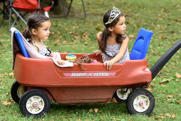 From the left: Sisters AdaLynn Hargett, 2 and RaeLynn Hargett, 3, get the royal treatment as they check out the sights, sounds and smells during the Carl Junction Bluegrass Festival on Saturday at Center Creek Park. <br /> Globe | Laurie SIsk