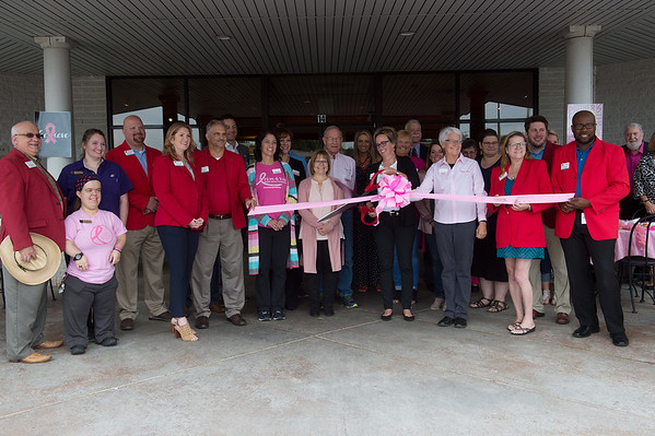 Michelle Wood, honary chair of Breast Cancer Awarenesss Month for Hope 4 You, cuts the ribbon to celebrate the start of Pink Ribbon Bagel month at Panera on Thursday. For every Pink Ribbon Bagel sold during the month of October, Panera will donate 25 cents to Hope 4 You, and on Oct. 18th 100% of the proceeds will go to the organization.<br /> Globe | Roger Nomer