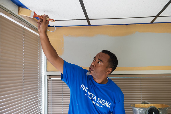 Kenyae Black, with the Springfield chapter of the Phi Beta Sigma Fraternity, paints at the Community Service Center on Friday.<br /> Globe | Roger Nomer