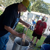 (from left) Dan Weaver talks with Brant Smith and his uncle Farand Smith while brewing beer on Friday during the Ozarks Homesteading Expo at the Newton County Fairgrounds.<br /> Globe | Roger Nomer