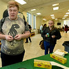 Missouri Southern freshman Josh Kayser reacts after trying vegemite spread on a cracker as fellow freshman Dock Graber looks on Wednesday at MSSU's Billingsly Student Center. The event was part of MSSU's Oceania semester and included a green screen photo opportunity in which students could place themselves in a photo of iconic landmarks.<br /> Globe| Laurie Sisk