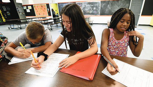 From the left: Ten-year-olds Crew Nixon, Audrey Frossard and Amari Travis form a study group to work on homework on Tuesday afternoon at the Boys and Girls Club of Southwest Missouri.<br /> Globe | Laurie Sisk
