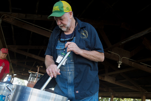 Dan Weaver brews a batch of beer on Friday during the Ozarks Homesteading Expo at the Newton County Fairgrounds.<br /> Globe | Roger Nomer