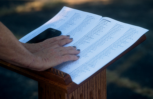 Debb Ollis, VFW auxiliary member, reads names of those killed on Sept. 11, 2011, at the Joplin VFW on Wednesday.<br /> Globe | Roger Nomer