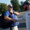 Steven Roberts, left, greets Matt Hay before Monday's practice ruck along the Frisco Greenway Trail. <br /> Globe | Roger Nomer