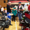 Bruce Clemons, with the VFW Post 1186 in Independence, Kan., left, talks with Rodney Bray, a ride director for the American Legion Riders, during Thursday's Veterans Expo at Joplin Memorial Hall.<br /> Globe | Roger Nomer