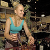 Angela Harris mixes fragrances from handmade natural ingredients at her Alchemist Haven booth on Saturday at the Empire Market. Harris' fragrances are customized for the individual buyer and contain a variety of choices, from lemongrass, to lavender, eucalyptis, spearmint and more.<br /> Globe | Laurie Sisk