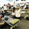 Kansas City University students and West Central Elementary students take part in KCU's Score 1 for Health event on Tuesday at KCU. The children's preventative screening program involved about 130 West Central Elementary students and included basic health screenings and educational presentations for the kids.<br /> Globe | Laurie Sisk