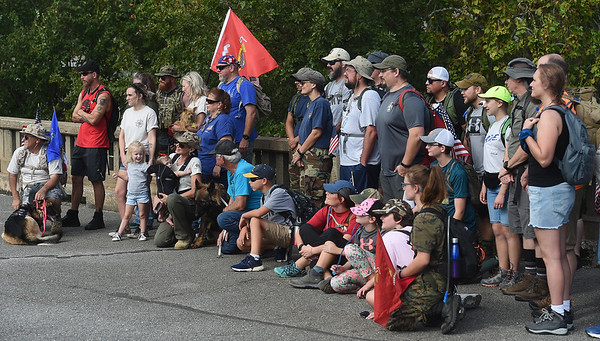 """PArticipants and supporters of the the """"Let's Roll '19 Ruck March"""" gather for a pre-march photo on Saturday at Redings Mill Bridge. The event, sponsored by Compass Quest, included about 30 participants who hiked the 14-mile course to raise awareness concerning veteran's issues.<br /> Globe   Laurie Sisk"""
