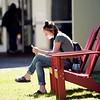 BEN GARVER — THE BERKSHIRE EAGLE<br /> Hannah Sturdivant relaxes in the sunshine at Berkshire Community College near the Library.