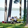 BEN GARVER — THE BERKSHIRE EAGLE<br /> Junior Pierre and Brenda Belizare (closest to camera) and Ray and Sheila Shepardson enjoy lunch in the pines at Pontoosuc Lake in Pittsfield.