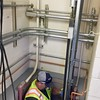 HEATHER BELLOW — THE BERKSHIRE EAGLE<br /> Wastewater department employee Jerry Morey climbs down to check the<br /> pumps and hand-remove wipes that are slowing them down and threatening<br /> to break them.