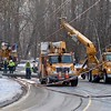 BEN GARVER — THE BERKSHIRE EAGLE<br /> Crews work to repair power lines on Hubbard Ave. (near the Dalton Ave end) after a morning car accident.