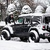 BEN GARVER — THE BERKSHIRE EAGLE<br /> Jeff Sprague climbs his Jeep  to clean the snow off in Pittsfield, Wednesday, November 28, 2018.