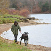 GILLIAN JONES — THE BERKSHIRE EAGLE<br /> Ken Lake walks his dog Hunter, a 7 year old Great Dane, along the shoreline of Onota Lake in Pittsfield. With temperatures only reaching the high 30's to low 40's only a handful of souls were out at the popular recreational area. Tuesday, November 7, 2017.