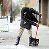 BEN GARVER — THE BERKSHIRE EAGLE<br /> Rob Starbard shovels off ice in front of the Beacon Cinema in Pittsfield, Monday December 30, 2019.