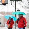 BEN GARVER — THE BERKSHIRE EAGLE<br /> A couple walks in the sleet on South Street, Monday December 30, 2019.