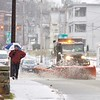 BEN GARVER — THE BERKSHIRE EAGLE<br /> A man walks across a bridge on West Housatonic Street in Pittsfield. The plow behind him is the largest in Pittsfield, used to keep the main roads clear. Monday December 30, 2019.
