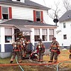 BEN GARVER — THE BERKSHIRE EAGLE<br /> Pittsfield firefighters clean up after putting out a house fire at 82 Elmhurst, Monday December 30, 2019.